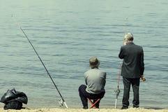 Uomini sulla pesca Fotografia Stock Libera da Diritti