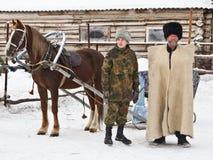 Uomini in vestiti tradizionali. Immagini Stock