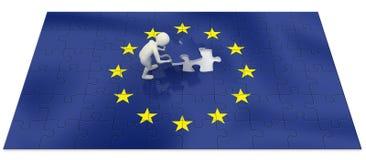 uomo 3d che finisce puzzle della bandierina di Unione Europea Immagini Stock