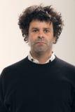 Uomo adulto con capelli ricci Fotografie Stock