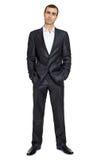 Uomo adulto in vestito nero che posa, fondo bianco dello spazio fotografie stock