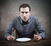 Uomo affamato immagine stock libera da diritti