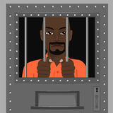 Uomo afroamericano che guarda da dietro le barre Immagine Stock Libera da Diritti