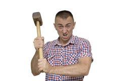 Uomo aggressivo con una mazza su un fondo bianco Lavoro c fotografie stock libere da diritti