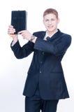 Uomo allegro che mostra bibbia fotografia stock