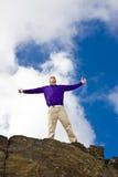 Uomo alzato delle braccia Fotografia Stock