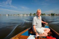 Uomo anziano in barca Fotografia Stock Libera da Diritti
