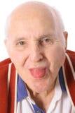 Uomo anziano che attacca fuori la sua linguetta Immagine Stock Libera da Diritti