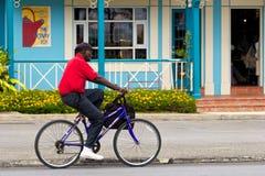 Uomo anziano che guida una bici, Barbados Fotografia Stock Libera da Diritti