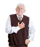 Uomo anziano che ritiene cattivo Fotografia Stock