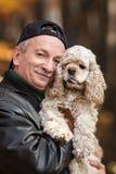 Uomo anziano con il cane Fotografia Stock Libera da Diritti