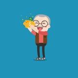 Uomo anziano con il porcellino salvadanaio dorato Fotografie Stock