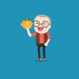 Uomo anziano con il porcellino salvadanaio dorato Immagine Stock Libera da Diritti
