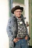 Uomo anziano dell'azienda agricola Immagine Stock
