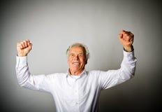 Uomo anziano di esultanza Immagine Stock