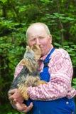 Uomo anziano ed il suo cane Fotografia Stock