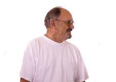 Uomo anziano felice con le protesi acustiche. immagini stock libere da diritti