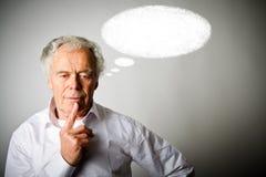 Uomo anziano nella bolla bianca e bianca fotografia stock