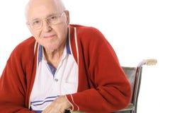 Uomo anziano in sedia a rotelle Fotografia Stock Libera da Diritti