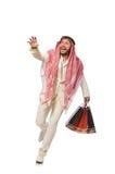 Uomo arabo con i sacchetti della spesa su bianco Fotografia Stock Libera da Diritti