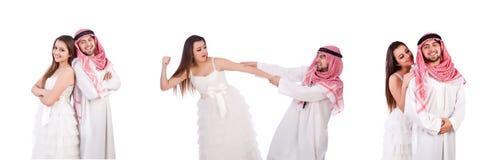 Uomo arabo con la sua moglie su bianco fotografie stock
