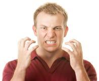 Uomo arrabbiato che serra i denti fotografia stock libera da diritti