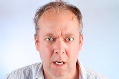 Uomo arrabbiato circa qualcosa Immagini Stock Libere da Diritti
