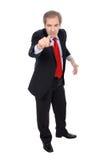 Uomo arrabbiato di affari che indica la sua barretta Fotografia Stock Libera da Diritti