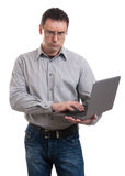 Uomo arrabbiato di affari con il computer portatile Fotografia Stock