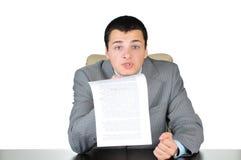 Uomo arrabbiato di affari sul lavoro immagine stock