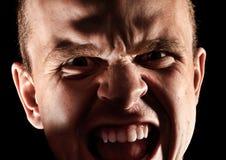 Uomo arrabbiato sul nero Fotografia Stock Libera da Diritti