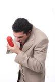 Uomo arrabbiato sul telefono Fotografia Stock Libera da Diritti