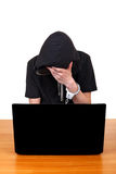 Uomo arrestato con il computer portatile Fotografia Stock Libera da Diritti