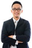 Uomo asiatico astuto di affari isolato su fondo bianco Immagini Stock Libere da Diritti