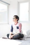 Uomo asiatico che contempla Fotografia Stock