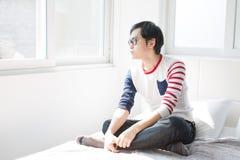 Uomo asiatico che contempla Immagine Stock Libera da Diritti