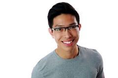 Uomo asiatico che sta con il computer della compressa Fotografia Stock