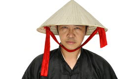Uomo asiatico con il cappello del Vietnam Immagini Stock
