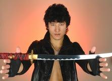 Uomo asiatico con il katana Fotografia Stock
