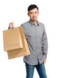 Uomo asiatico con il sacchetto della spesa Immagini Stock