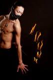 Uomo asiatico con l'esposizione del fuoco Fotografie Stock