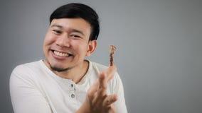 Uomo asiatico con l'osso del pollo Immagine Stock Libera da Diritti