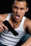 Uomo asiatico della pistola Immagini Stock Libere da Diritti
