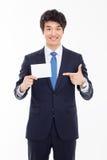 Uomo asiatico di affari con la carta in bianco. Immagini Stock Libere da Diritti