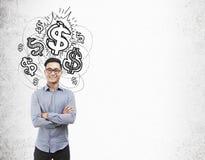 Uomo asiatico ed icone brillanti dei dollari Immagini Stock