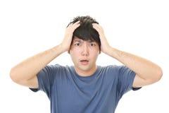 Uomo asiatico frustrato Immagine Stock