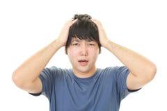 Uomo asiatico frustrato Fotografie Stock