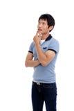 Uomo asiatico giovane di pensiero Immagini Stock Libere da Diritti