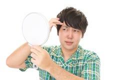 Uomo asiatico insoddisfatto fotografie stock