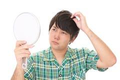 Uomo asiatico insoddisfatto fotografie stock libere da diritti